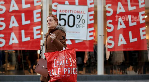 A shopper takes advantage of the Boxing Day sales in Liverpool city centre (PA)