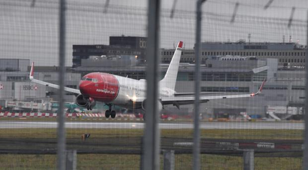 A Norwegian Airlines plane lands at Gatwick Airport (John Stillwell/PA)