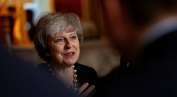 Prime Minister Theresa May said it is time to 'focus on what really matters' (Adrian Dennis/PA)