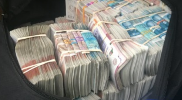 Cash seized from a vehicle on the M6 (NCA/PA).