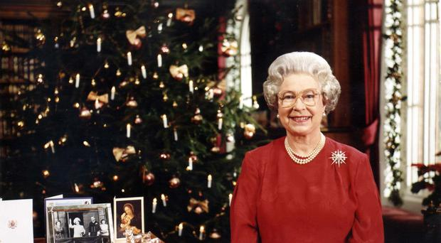 The Queen delivering her annual Christmas message to Britain and the Commonwealth (PA)