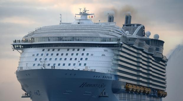 File photo dated 17/05/16 of Harmony of the Seas, owned by Royal Caribbean. A British cruise ship entertainer is missing after going overboard from the vessel on Christmas Day.
