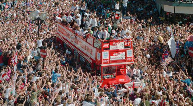 Thousands of fans surround the England team bus (Malcolm Croft/PA)