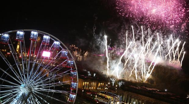 Fireworks light up the sky during the Hogmanay New Year celebrations to bring in 2018 in Edinburgh (David Cheskin/PA)