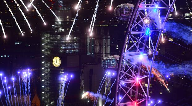 Fireworks light up the sky over the London Eye (Victoria Jones/PA)