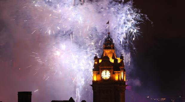 Fireworks light up the sky in Edinburgh during the Hogmanay New Year celebrations (Andrew Milligan/PA)