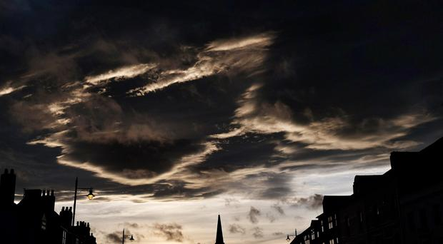 Storm clouds at night over Tynemouth (Owen Humphreys/PA)