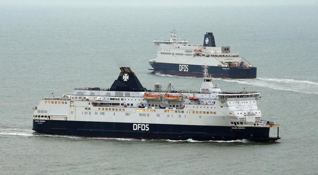 The DFDS Dunkerque Seaways (top) and the Calais Seaways (bottom) arrive and leave the Port of Dover in Kent (Gareth Fuller/PA)
