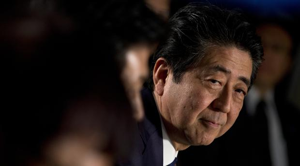 Japan's Prime Minister Shinzo Abe visited the Netherlands on the eve of his trip to the UK (AP Photo/Peter Dejong)