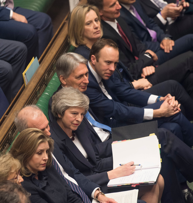Prime Minister Theresa May and members of her front bench during Prime Minister's Questions in the House of Commons yesterday