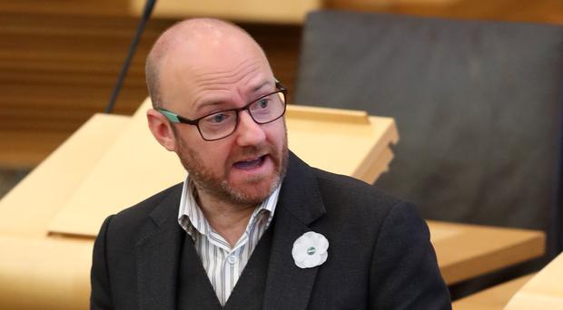 Scottish Green Party leader Patrick Harvie raised the issue of budget cuts during First Minister's Questions (PA)