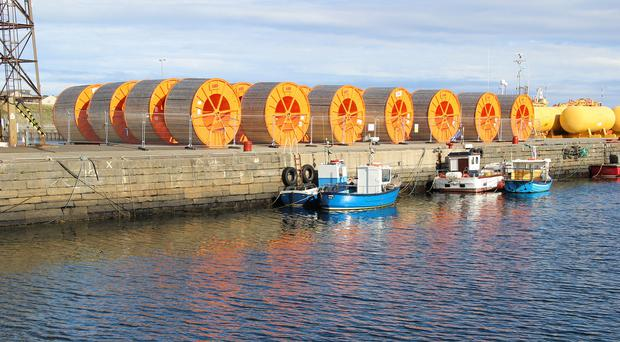 Cable drums at Wick harbour used in the project (SSEN/PA)
