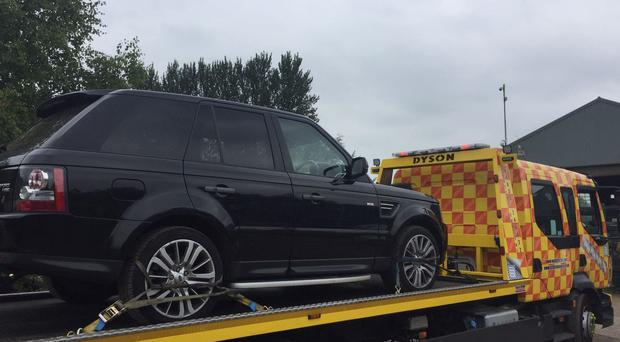 A stolen Jaguar Land Rover car recovered from Edward Barrington's business premises (Gloucestershire Police/PA)
