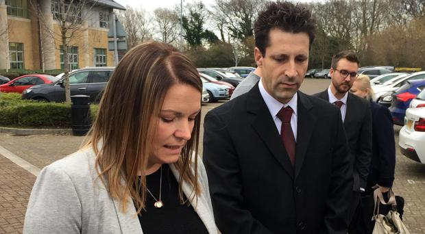 Lorraine Brown, the mother of Alexys Brown, with Health and Safety Executive (HSE) inspector Leo Diez, reads a statement outside Bournemouth Crown Court after two companies were fined �1.5 million following the death of her daughter.