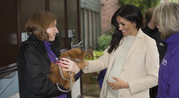 The Duchess of Sussex meets Foxy during a visit to Mayhew, an animal welfare charity she is now supporting as patron, at its offices in north-west London.