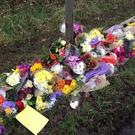 Flowers left in Barns Green, West Sussex, for William Hallet, 15 and his grandfather Barry Hearnshaw, 72, who were killed on a level crossing.