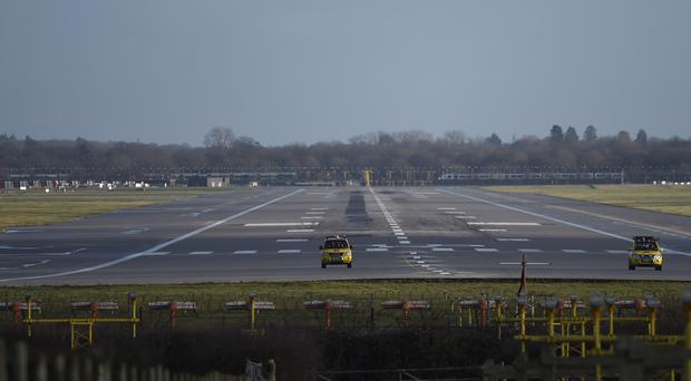 Service vehicle on the runway at Gatwick airport which was closed after drones were spotted (Pete Summers/PA)