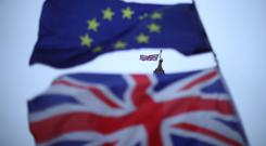 The EU and Union flags flying outside Parliament (Yui Mok/PA)