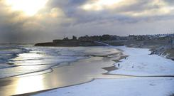 Snowfall on Tynemouth beach (Owen Humphreys/PA)