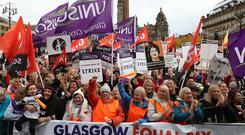 Thousands of council workers in Glasgow went on strike in support of the equal pay claim (Andrew Milligan/PA)