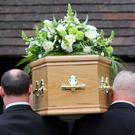 The Scottish Government will this summer introduce a new benefit to help with funeral expenses (PA)