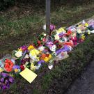 Flowers left in Barns Green, West Sussex, for William and his grandfather Barry Hearnshaw (Flora Thompson/PA)