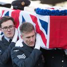 A coffin is carried into the crematorium during the funeral of 101-year-old Dambusters engineer Victor Barnett and his wife Edna (Aaron Chown/PA Wire)