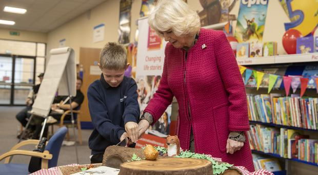 Delighted Nine Year Old Helps Camilla Cut Cake During Library Visit