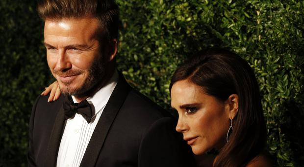 David and Victoria Beckham paid £12.7 million in tax last year (Jonathan Brady/PA)