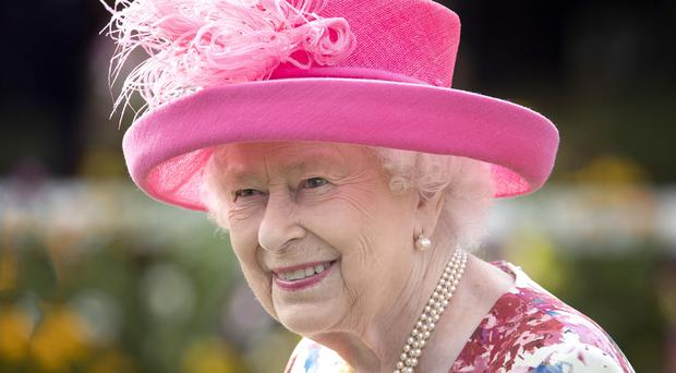The Queen will reflect upon her father's death and her accession to the throne in private at Sandringham (Jane Barlow/PA)