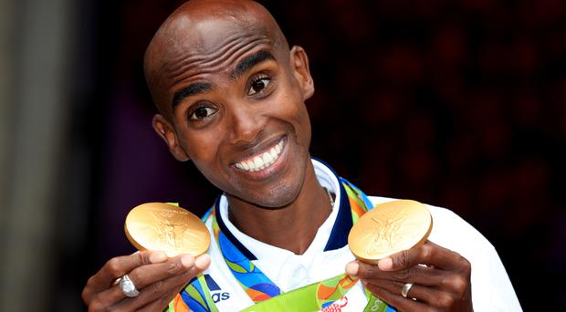 Great Britain's Mo Farah with his gold medals for victory in the Men's 5000m and 10000m during a photocall at British House, Parque Lage, Rio de Janeiro (Mike Egerton/PA)