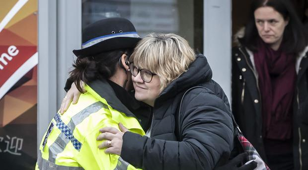 Lisa Squire, mother of missing student Libby Squire, hugs a police officer outside Hull Community Church (Danny Lawson/PA)