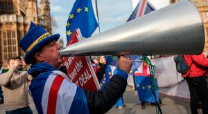 Anti-Brexit protesters demonstrate in front of the Houses of Parliament yesterday