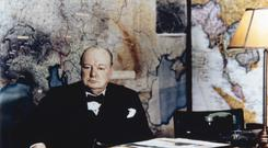 Winston Churchill seated at his desk in the No 10 Annexe Map Room, May 1945 (Imperial War Museums/PA)