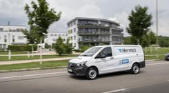 """Courier firm Hermes has said it is expecting a hit of around £10 million from its """"groundbreaking"""" deal to give new rights to self-employed drivers."""
