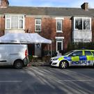 The emergency services outside an address in Bonhay Road, Exeter (Ben Birchall/PA Wire)