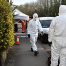 Forensic officers outside an address in Bonhay Road, Exeter, where the body of a man aged 80 was found on Monday afternoon (Ben Birchall/PA)