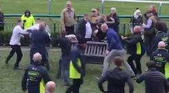 Still of a brawl at a Haydock Park race meeting on Merseyside (Oliver Hodgson/Twitter)