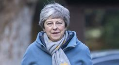 Theresa May vowed that the Government would continue its work to secure changes to the Irish border backstop (Steve Parsons/PA)