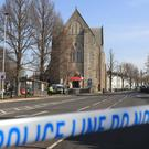 Police tape near St Joseph's Church in Brighton (Gareth Fuller/PA)