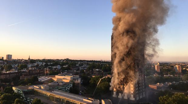 Smoke pours from the fire at Grenfell Tower in west London which killed 72 people (Natalie Oxford/PA)