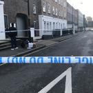 A police cordon in Euston Street in Camden, central London, where detectives are investigating the fatal stabbing of a man on Monday night (Tom Horton/PA)