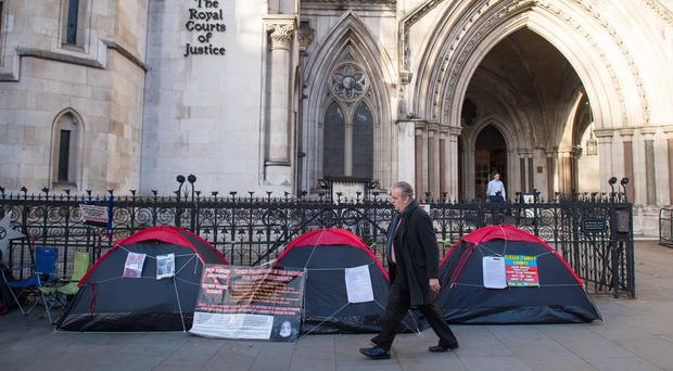 Tents outside the Royal Courts of Justice, where demonstrators are camping as part of a protest against 'secrecy' in family courts (PA)