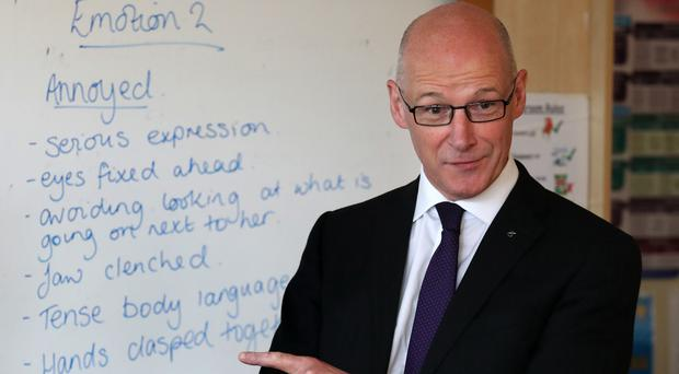 Education Secretary John Swinney said that he wants the education system to constantly improve (Andrew Milligan/PA)