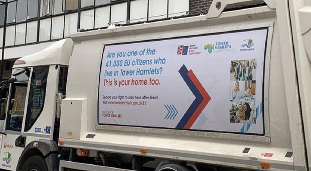 A bin lorry carries the message to EU residents 'this is your home too' (@Milo_Edwards/PA)