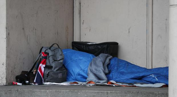 A homeless person sleeping rough in a doorway in Farringdon, London. (Yui Mok/PA Wire).