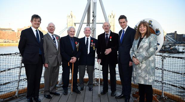 (Left to right) French Ambassador Jean-Pierre Jouyet, Royal Navy veterans Dennis William Haley, John George Nicholls, Charles Henry Kavanagh and Patrick John Reardon with Defence Secretary Gavin Williamson and Director-General of IWM Diane Lees onboard HMS Belfast in London (Kirsty O'Connor/PA)
