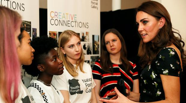 The Duchess of Cambridge speaks to members of the National Portriat Gallery's Youth Forum (John Sibley/PA)