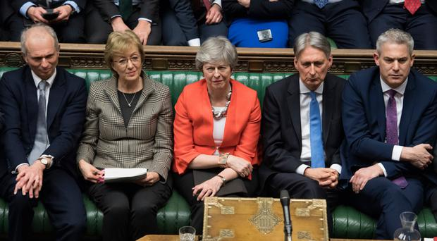 Prime Minister Theresa May reacts last night after her Brexit deal was rejected by MPs in the Commons
