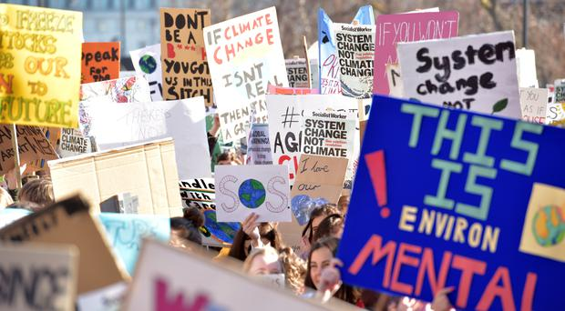 Students from the Youth Strike 4 Climate movement protest outside Downing Street in February (Nick Ansell/PA)